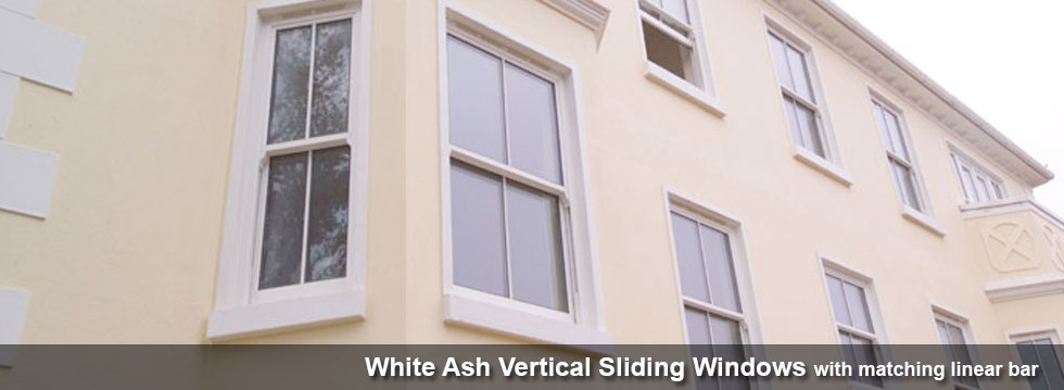 White Ash Vertical Sliding Windows